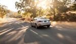 Nuevo Mazda6 parte posterior en carretera atardecer
