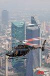 CabiFLY Shuttle helicóptero en servicio en la CDMX frente edificios