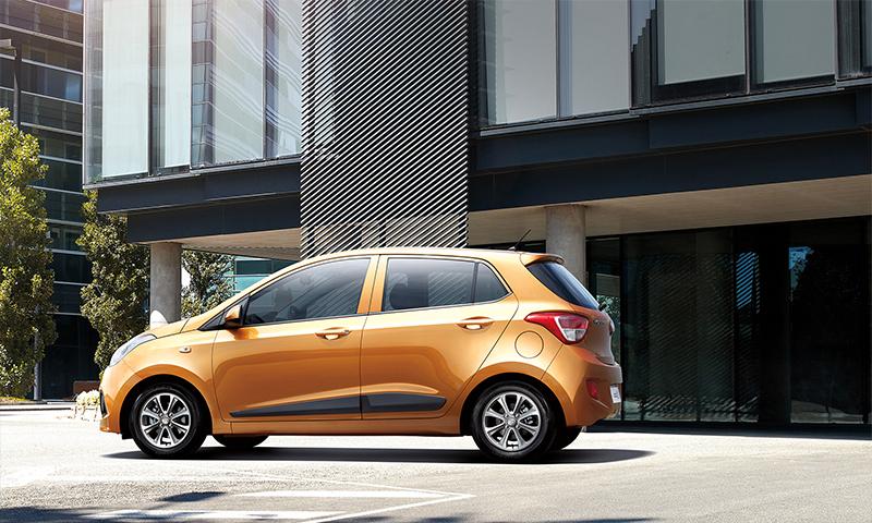 Hyundai Grand i10 México color naranja lateral